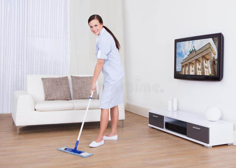 cleaning living room cleaning floor with mop stock image image 46360869 11210
