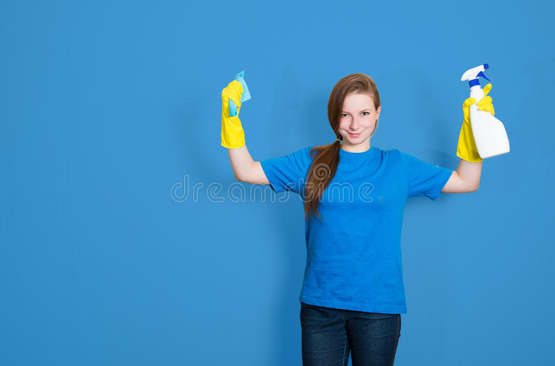 Maid cleaning woman with cleaning spray bottle. Cleaning service stock photo