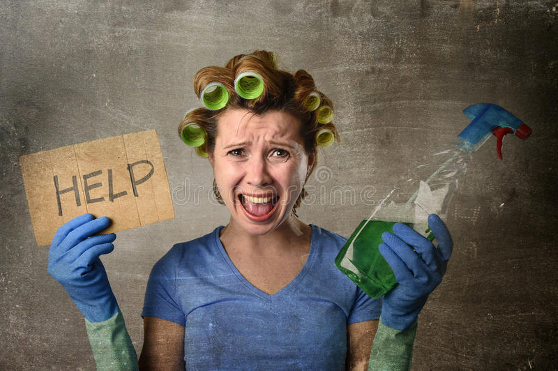 Maid cleaning woman in hair rollers with washing spray bottle asking for help stock photo