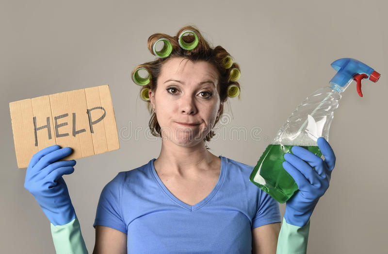 Maid cleaning woman or lazy housewife in stress in rollers with spray bottle asking for help stock photos