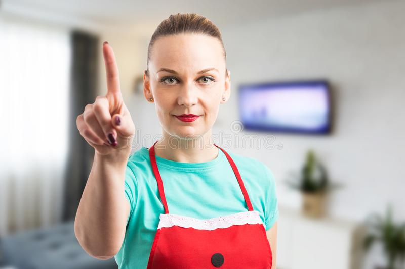 Maid or housekeeper touching invisible transparent screen display royalty free stock photography