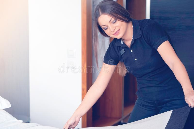 Maid Making Bed royalty free stock images