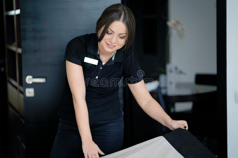 Maid Making Bed stock photo