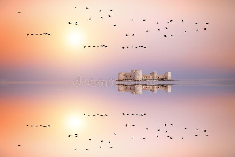 Maiden`s castle, Kiz Kalesi in Mediterranean Sea. Mersin Turkey. Maiden castle, Girl castle in Mersin Turkey, castle in the sea, castle of maiden, kizkalesi, kiz stock photo