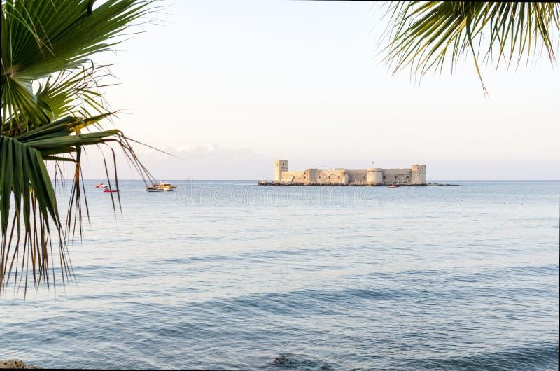 Maiden`s castle, Kiz Kalesi with palm in Mediterranean Sea. Mersin Turkey. Maiden`s castle, Kiz Kalesi with palm in Mediterranean Sea at Mersin Turkey royalty free stock image