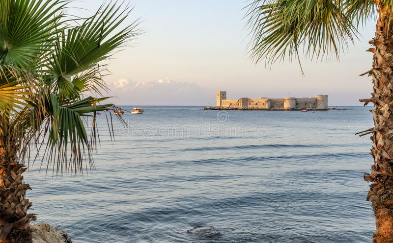 Maiden`s castle, Kiz Kalesi with palm in Mediterranean Sea. Mersin Turkey. Maiden`s castle, Kiz Kalesi with palm in Mediterranean Sea at Mersin Turkey royalty free stock photography