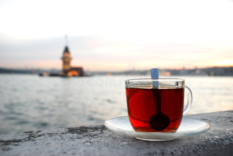 Maiden's Tower a cup of tea. The Maiden's Tower and a cup of tea in Ä°stanbul-Turkey stock photos