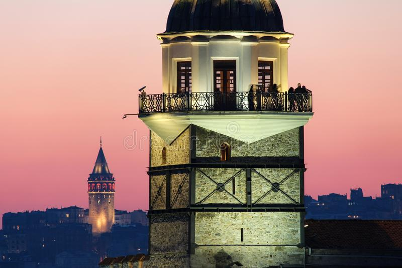 Maiden`s Tower and Galata Tower at sunset, Istanbul stock photo
