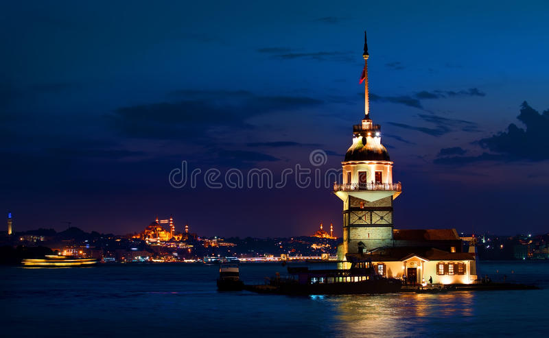 Maiden`s Tower at night. Maiden`s Tower and cityscape of Istanbul at night, Turkey royalty free stock photo