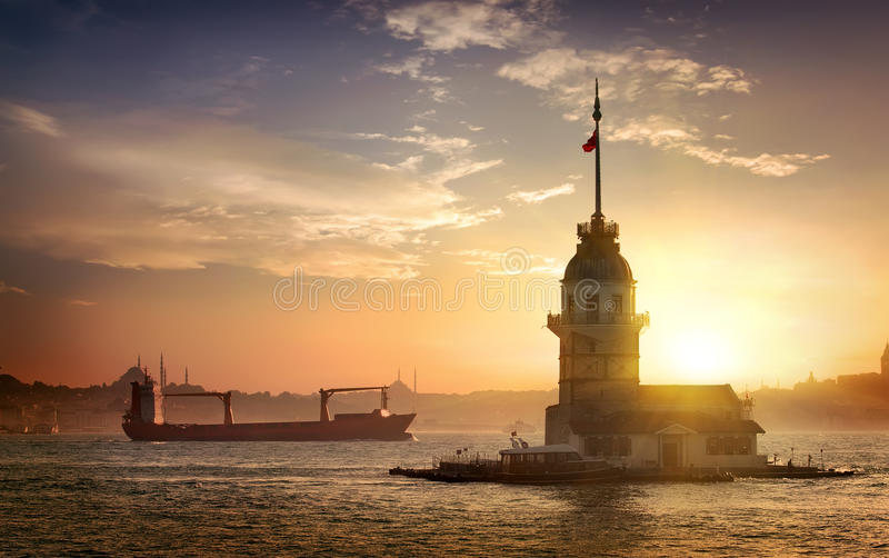 Maiden`s Tower and ships. In Istanbul at sunset, Turkey stock photos