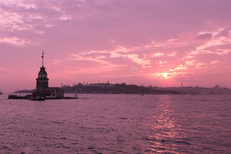 Maiden`s Tower with sunset sky in Istanbul, Turkey KIZ KULESI - USKUDAR.  stock image