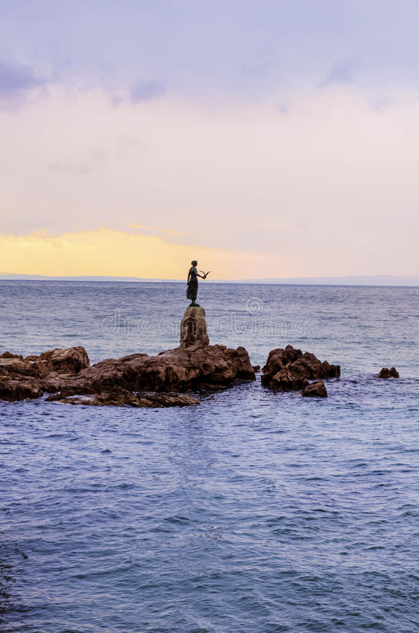 Maiden with the seagull statue with the Adriatic sea in the background in Opatia , Croatia stock images
