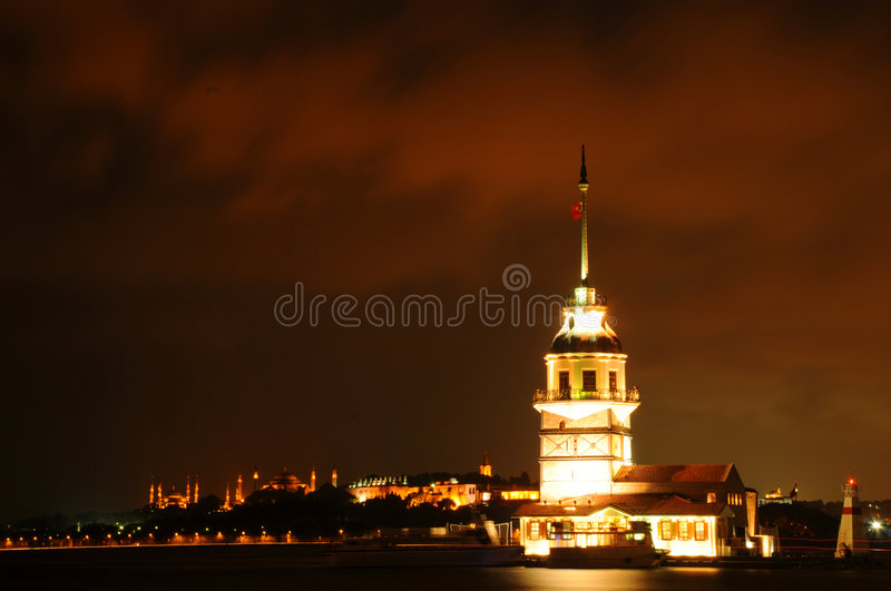 Maiden tower. Night view of maiden tower. Behind could be seen hagia sofia and blue mosque stock photography