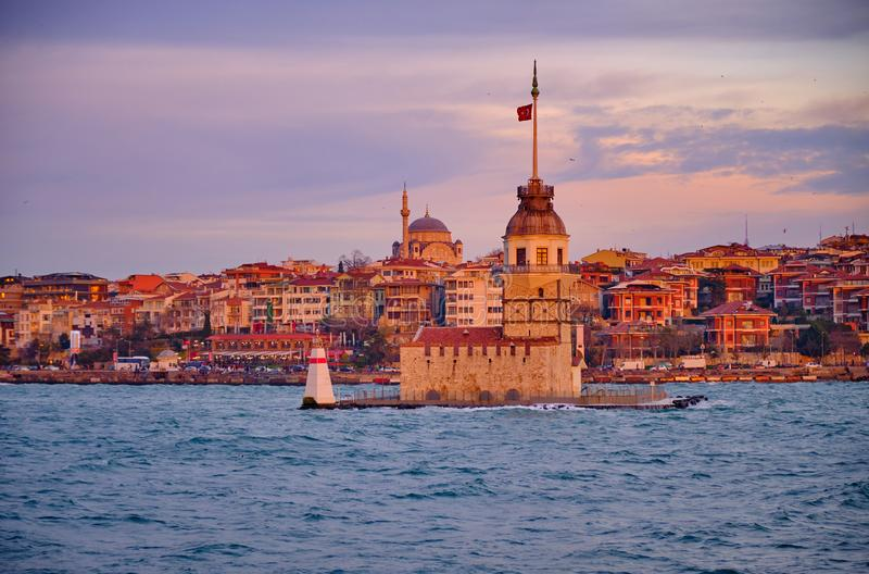 Maiden Tower Istanbul. The Maiden Tower as viewed from the ferry, with riverside area in background. Sunset capture, with wispy clouds. Istanbul, Turkey stock images