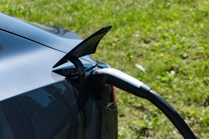 Detail of a Tesla car charging at the Tesla Super Charging Station in Maienfeld stock photography