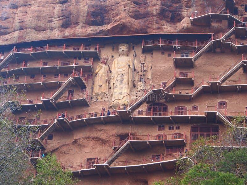 Maiji Shan Stone Mountain met oud boeddhistisch snijdend standbeeld stock afbeelding