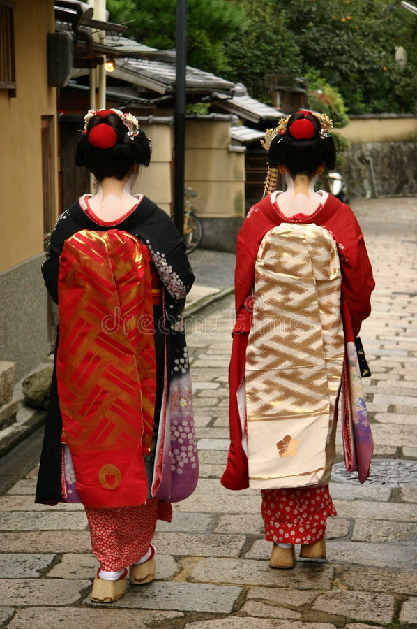 Maiko. Two maiko women walking down the street of Kyoto, Japan