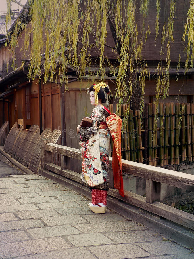 Woman in colorful Kimono dress at Gion district, Kyoto Japan. Young woman in Maiko Kimono dress at old-fashioned town of Gion district, Kyoto Japan royalty free stock photos