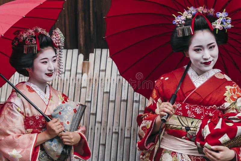 Maiko geishas walking on a street of Gion. Maiko geisha walking on a street of Gion in Kyoto Japan stock photos
