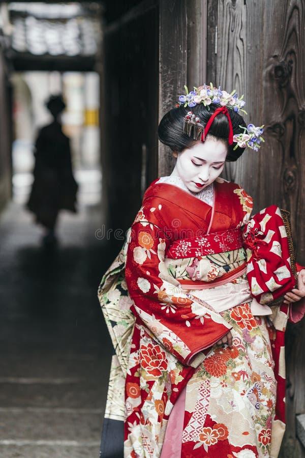 Maiko geishas walking on a street of Gion. Maiko geisha walking on a street of Gion in Kyoto Japan stock photography