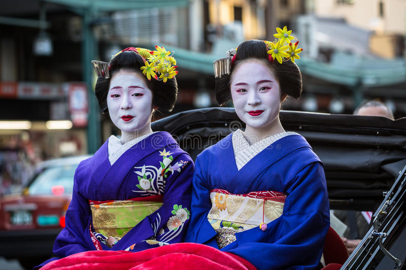 Maiko women, apprentice geisha on the street of Kyoto, Japan royalty free stock image