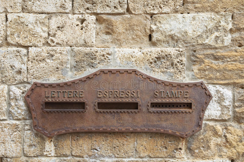 Mail box on stone wall wall stock photography