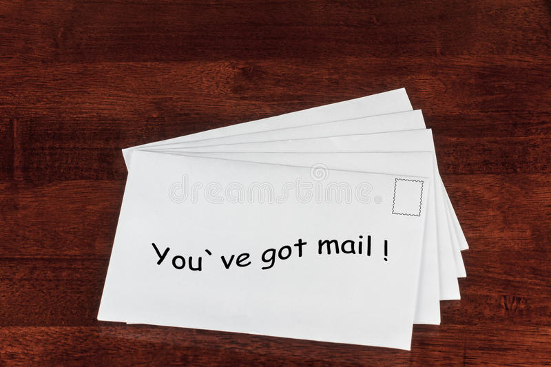 Mail. Conceptual Image of White Envelopes with You've Got Mail Print on a Table stock photography