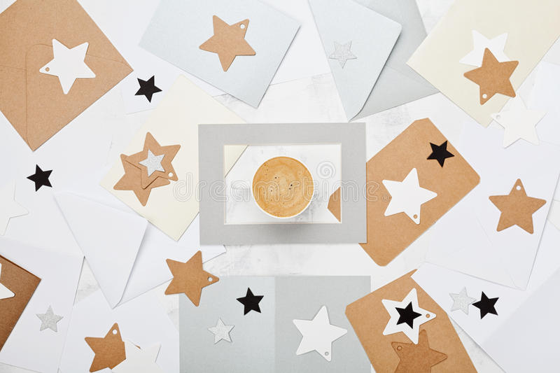Mail correspondence background or pattern with cup of coffee and envelopes decorated stars top view. Flat lay style. stock image