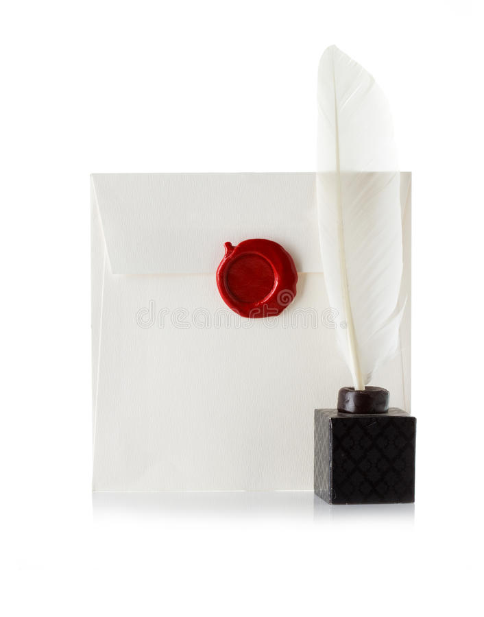 Mail envelope or letter sealed with wax seal stamp and quill pen stock photography