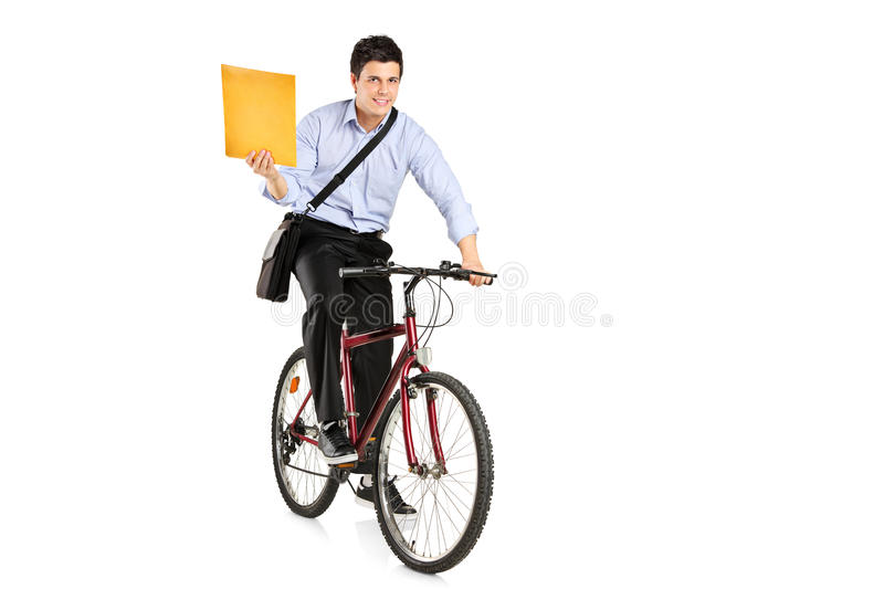 Mail man on a bicycle bringing mail. Isolated on white background royalty free stock image