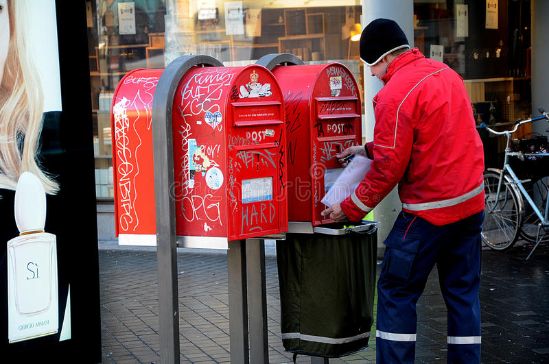MAIL MAN. Copenhagen / Denmark_ 15 February 2017 - Danish post man empty mail box . Photo. Francis Joseph Dean/Deanpictures royalty free stock image