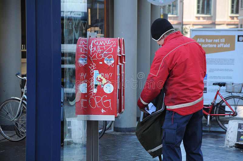 MAIL MAN. Copenhagen / Denmark_ 15 February 2017 - Danish post man empty mail box . Photo. Francis Joseph Dean/Deanpictures royalty free stock photography