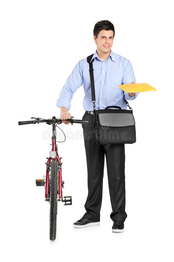 Mail man next to a bicycle holding an envelope. Isolated on white background royalty free stock photos
