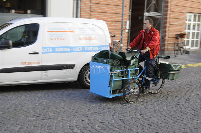 MAIL MAN FROM POSTNORD. 05 October 2016- Mail man works with postnord on delivery bike in Copenhagen / Denmark / Photo. Francis Joseph Dean/Deanpictures stock photos