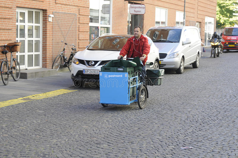 MAIL MAN FROM POSTNORD. 05 October 2016- Mail man works with postnord on delivery bike in Copenhagen / Denmark / Photo. Francis Joseph Dean/Deanpictures royalty free stock photography