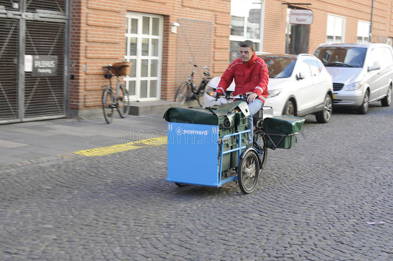 MAIL MAN FROM POSTNORD. 05 October 2016- Mail man works with postnord on delivery bike in Copenhagen / Denmark / Photo. Francis Joseph Dean/Deanpictures stock images