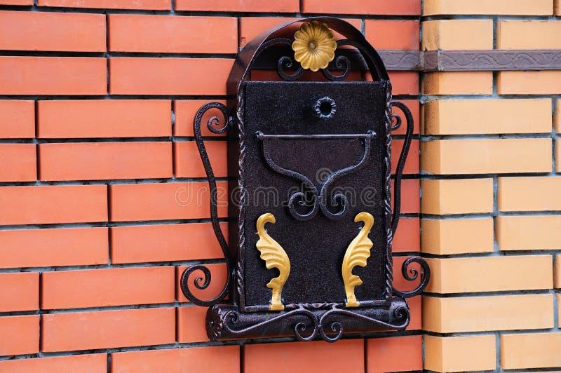 Mail metal box on a brick wall. royalty free stock photos