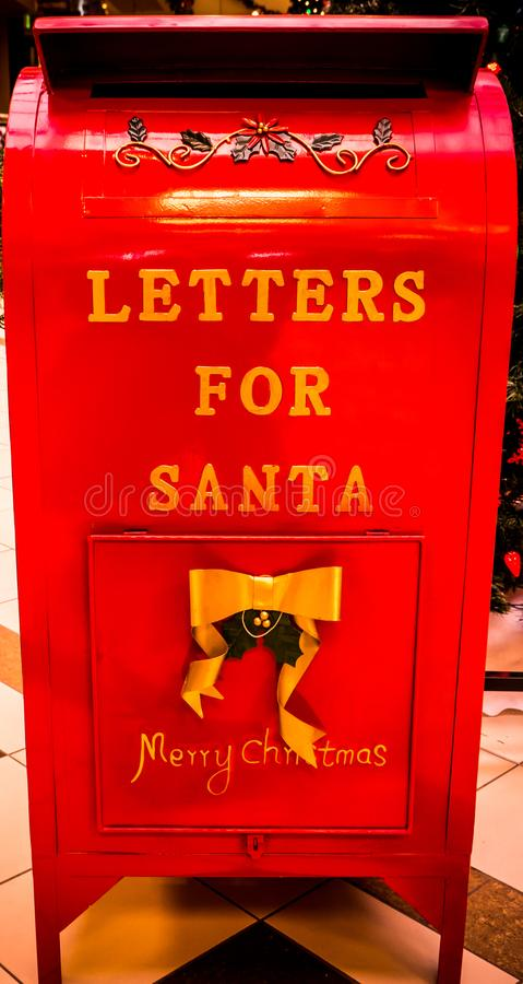 A Mailbox for Children to Mail Their Wish Lists to Santa. A mailbox for children to mail their whish lists to Santa stock photo