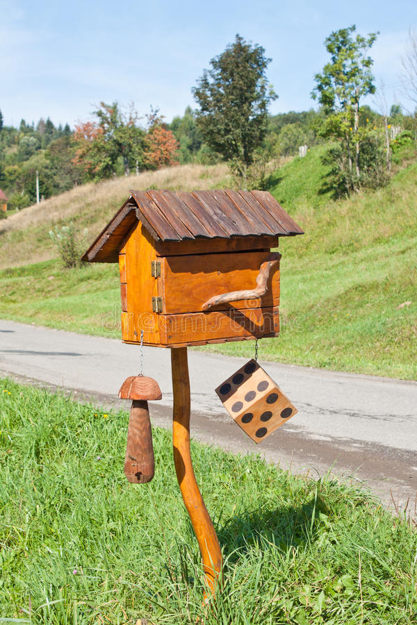 Mailbox. Home shaped wooden mailbox stay outdoor stock image