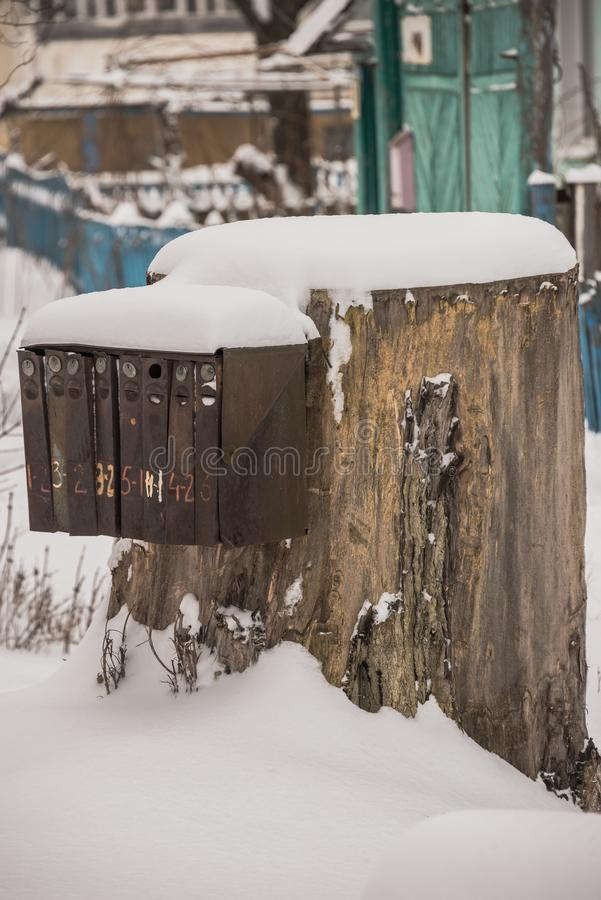 The mailbox nailed to the stump. Mailbox nailed to a tree stump in the village stock photo
