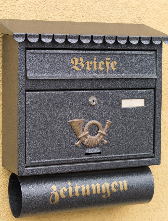 Mailbox and newspaper holder made of metal. Metal mailbox and newspaper holder stock images