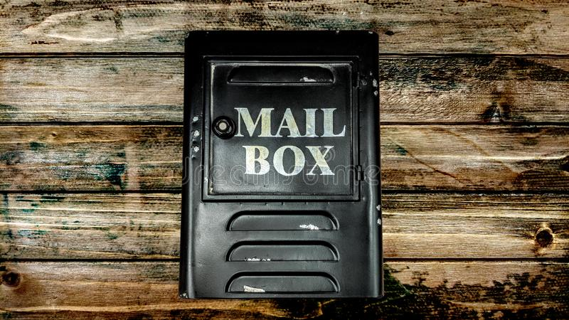 Mailbox on a wooden vintage plank wall royalty free stock photography