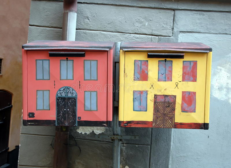 Mailboxes, painted like old houses stock images