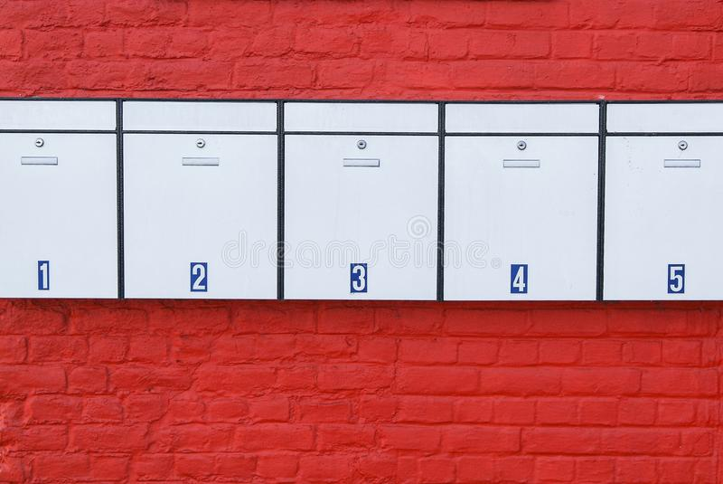 Download Mailboxes On Red Wall Royalty Free Stock Image - Image: 24700866
