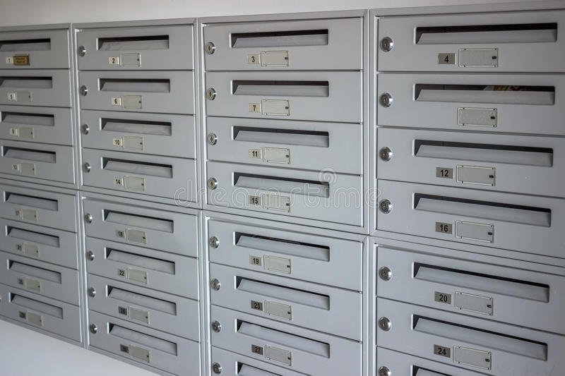 Mailboxes in a row. Name plates and lockers stock photo