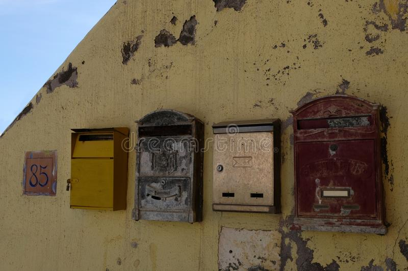 Mailboxes on a wall stock photo
