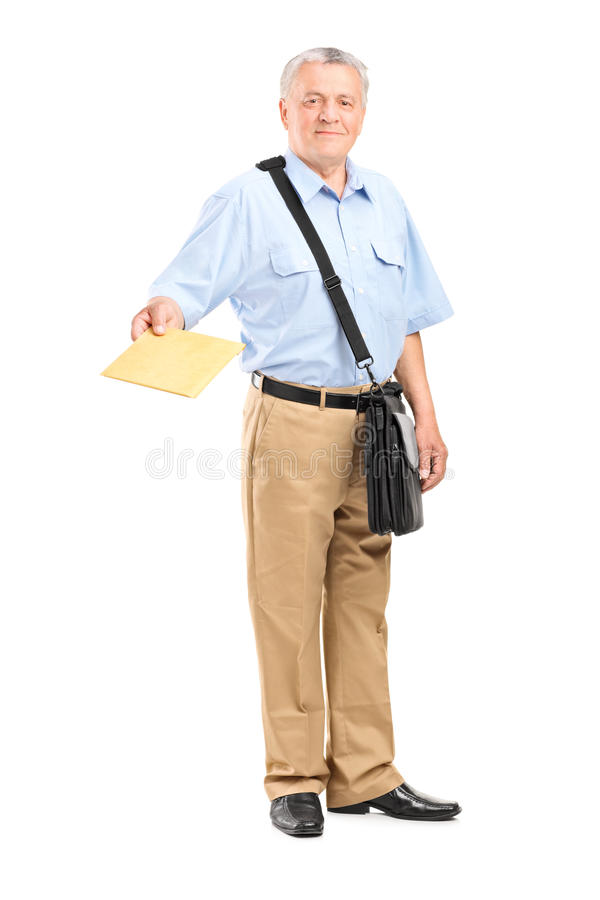 Mailman handing an envelope towards the camera. Full length portrait of a mailman handing an envelope towards the camera isolated on white background stock photography