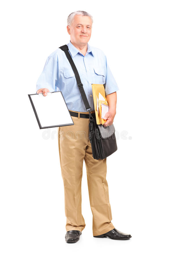 Mailman holding clipboard and bunch of envelopes. Full length portrait of a mailman holding clipboard and bunch of envelopes isolated on white background royalty free stock images
