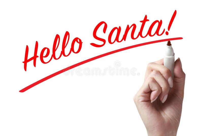 Main écrivant le bonjour Santa photo stock