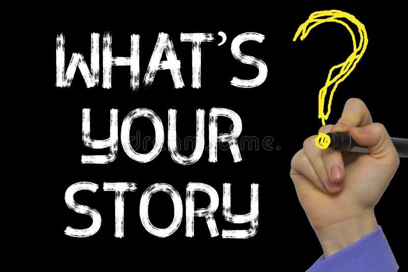 Main écrivant le texte : What's votre histoire photo libre de droits